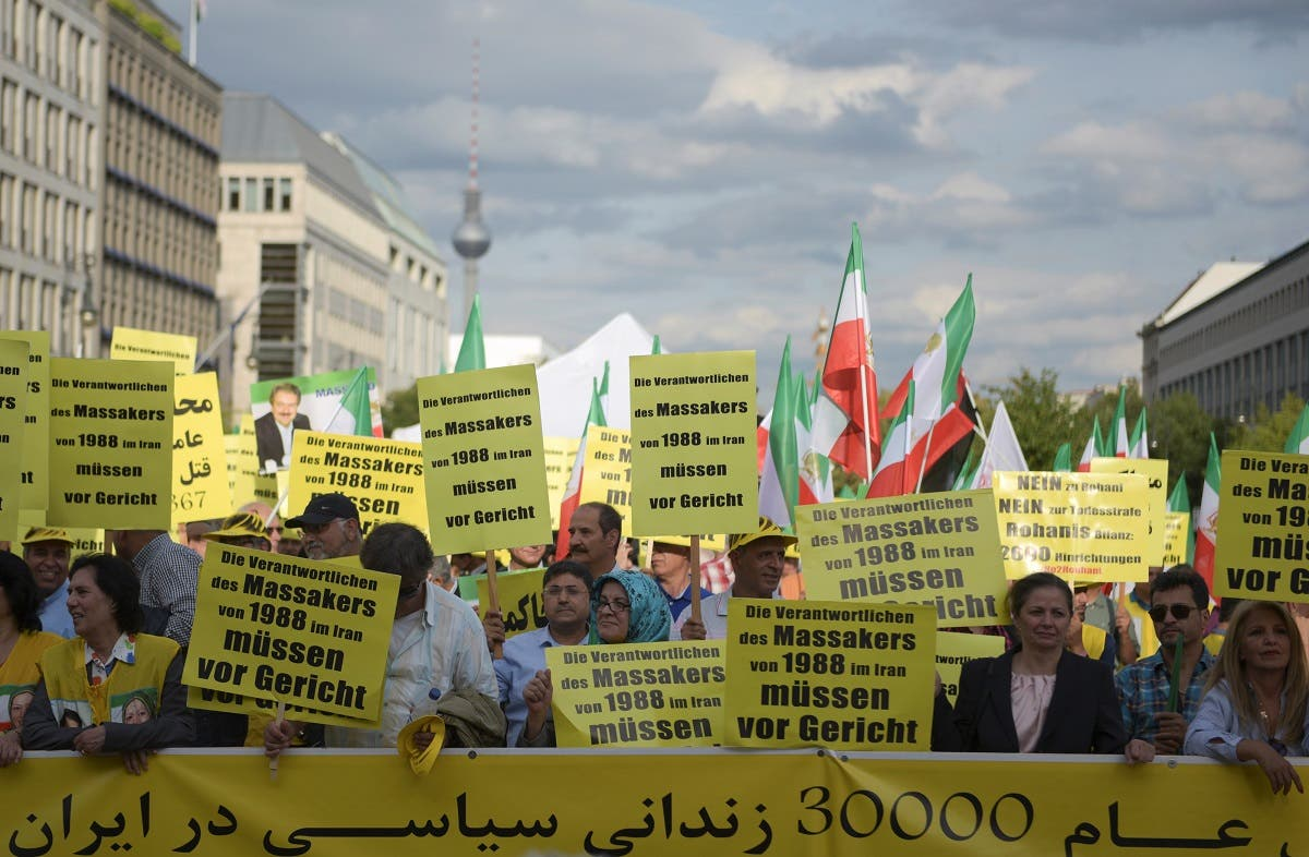 Activists hold banners during a demonstration against executions in Iran, in Berlin, Germany September 3, 2016. The banners in German read 'The people who are responsible for the 1988 massacres in Iran need to be brought to court.'  (Reuters)
