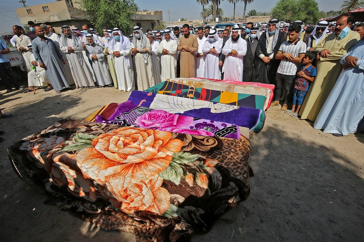Iraqis mourn the seven victims who were killed a day earlier when a rocket hit their home near Baghdad's airport, during their funeral on the outskirts of the capital, September 29, 2020. (AFP)