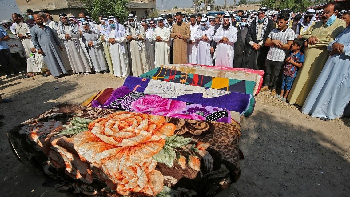 Iraqi men mourn the seven victims who were killed a day earlier when a rocket hit their home near Baghdad's airport, during their funeral in the Radwaniyah area on the outskirts of the capital,  September 29, 2020. (AFP)