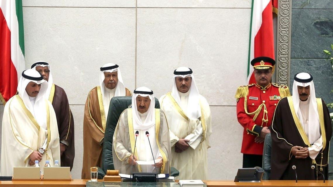 Emir of Kuwait Sheikh Sabah Al-Ahmad Al-Sabah (C) speaks as Kuwaiti crown prince Sheikh Nawaf al-Ahmad al-Sabah (R) and Kuwaiti parliament speaker Marzouq al-Ghanim (L) listen on during the opening ceremony of the new legislative year at the National Assembly in Kuwait City, on October 24, 2017. (AFP)
