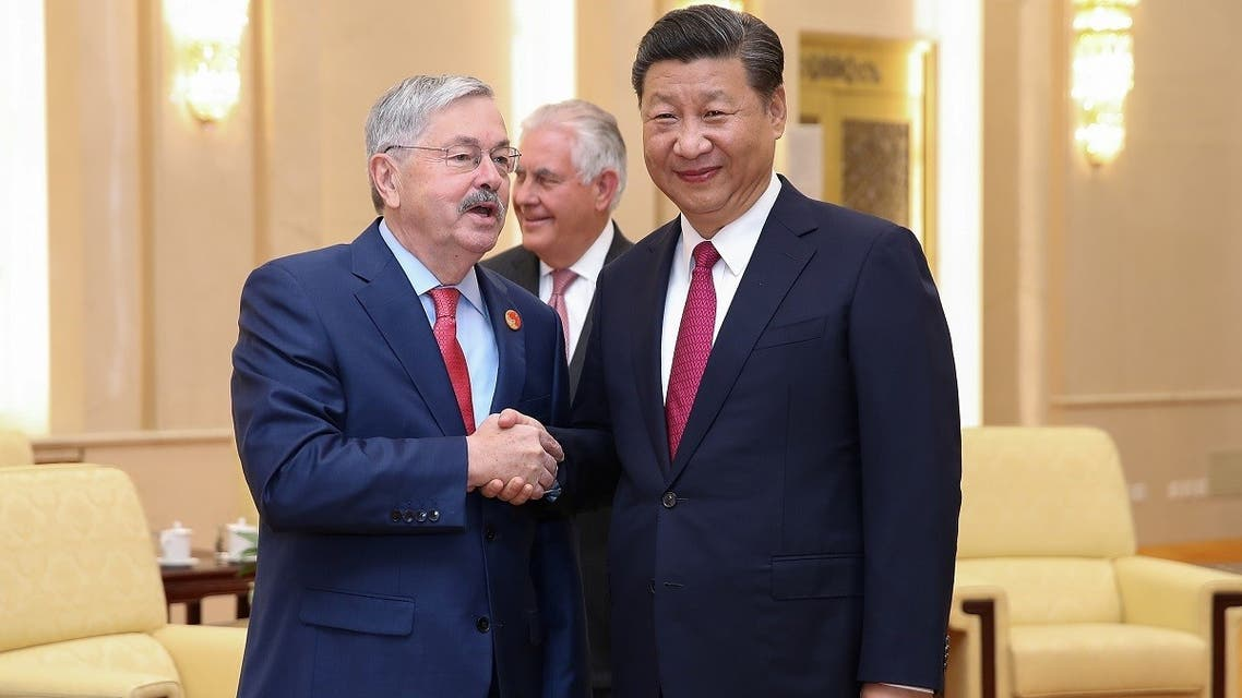 2US Ambassador Terry Edward Branstad (L) shakes hands with Chinese President Xi Jinping (R) at the Great Hall of the People on September 30, 2017 in Beijing, China. (Reuters)017-09-30T105449Z_1935685502_RC12BDFA21A0_RTRMADP_3_CHINA-USA