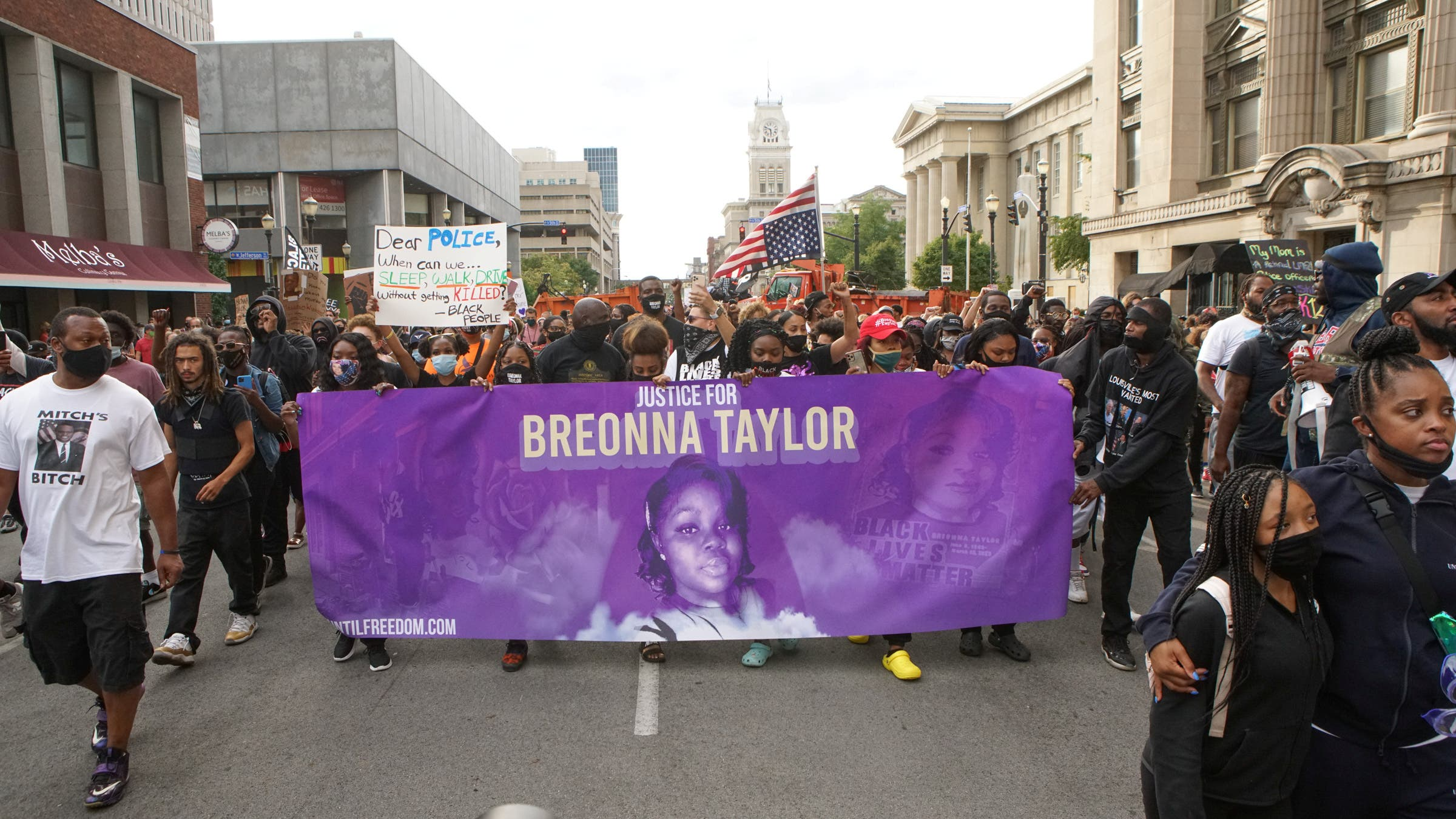Protesters march through downtown Louisville after a grand jury decided not to bring homicide charges against police officers involved in the fatal shooting of Breonna Taylor, in Louisville, Kentucky September 25, 2020. (Reuters)