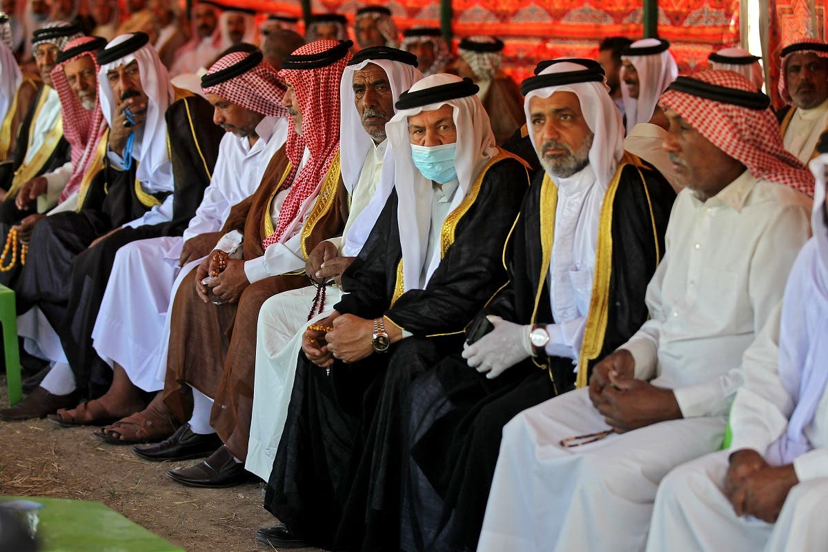 Iraqi tribal dignitaries attend the funeral of a family killed a day earlier when a rocket hit their home near Baghdad's airport, in the village of Al-Bu Shaban in the Radwaniyah area on the outskirts of the capital, on September 29, 2020. (AFP)