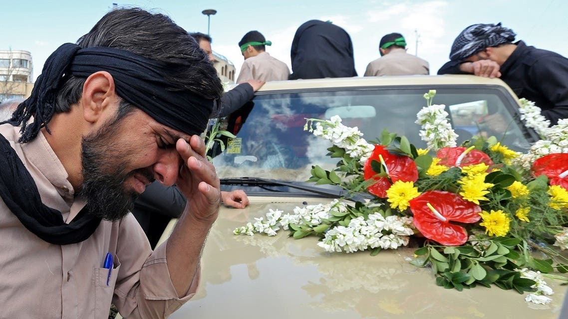 An Iranian man cries during the funeral of members of Revolutionary Guards, who were killed in a suicide attack, in the central Iranian city of Isfahan on February 16, 2019. (AFP)