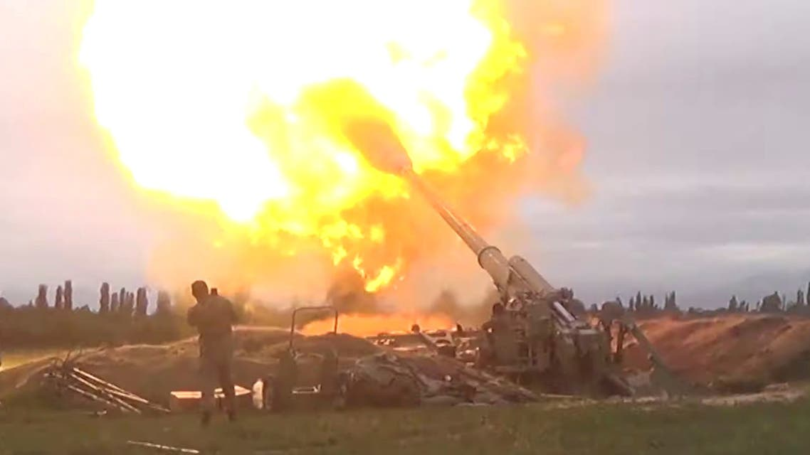 A still from Azerbaijan's Defense Ministry's video shows members of Azeri armed forces firing artillery during clashes between Armenia and Azerbaijan over Nagorno-Karabakh in an unidentified location, from footage released September 28, 2020. (Reuters)