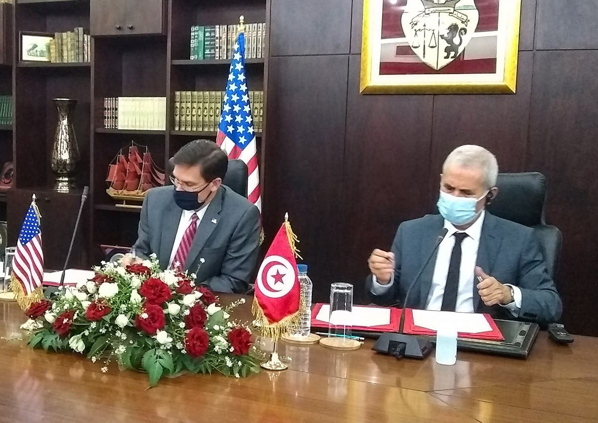 Esper (L) and his Tunisian counterpart Ibrahim Bartagi sign an agreement in the capital Tunis, on September 30, 2020. (AFP)