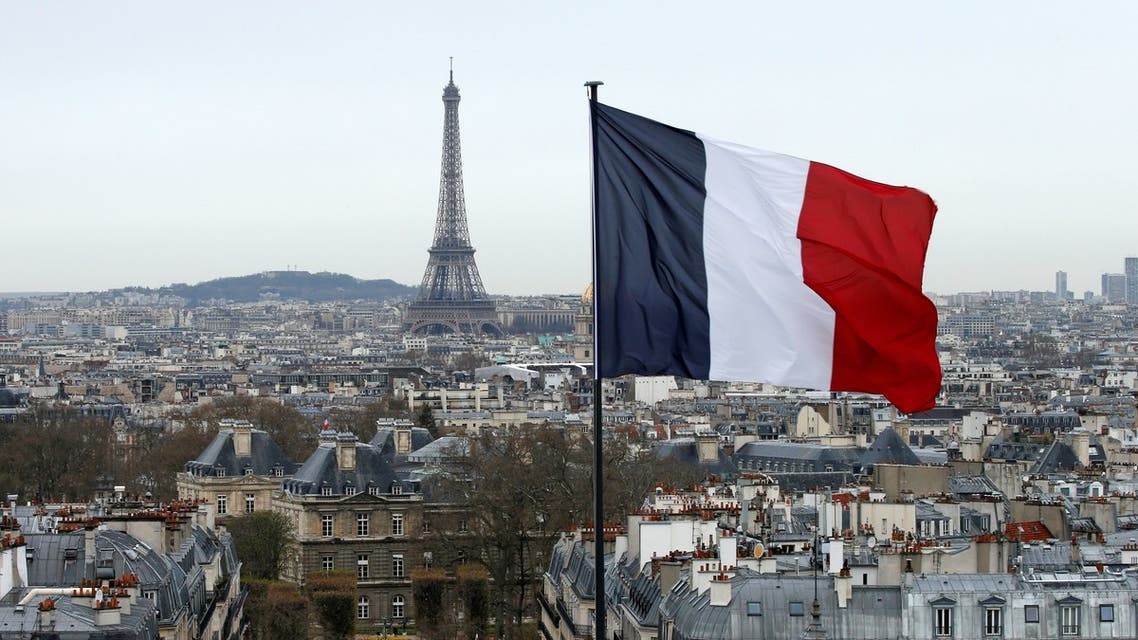 A French flag waves above the skyline as the Eiffel Tower and roof tops are seen in Paris, France. (Reuters)