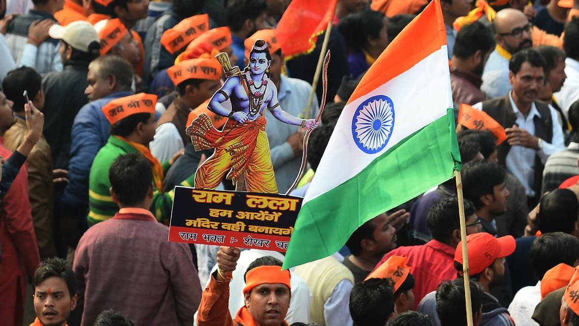 An Indian Hindu hardliner holds a cutout of Hindu God Ram as he participates in a rally calling for the construction of a temple on the site of the demolished 16th century Babri mosque - AFP