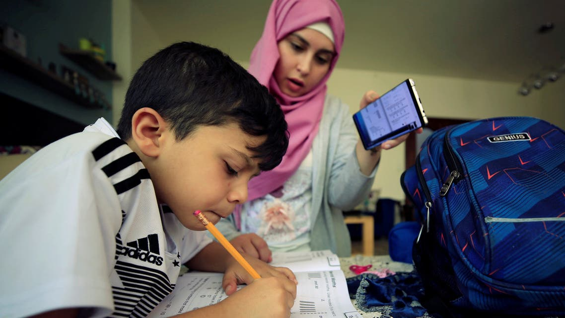A boy studies online from home as schools close to prevent the spread of the coronavirus disease (COVID-19) in Sidon, Lebanon, June 2, 2020. (Reuters)