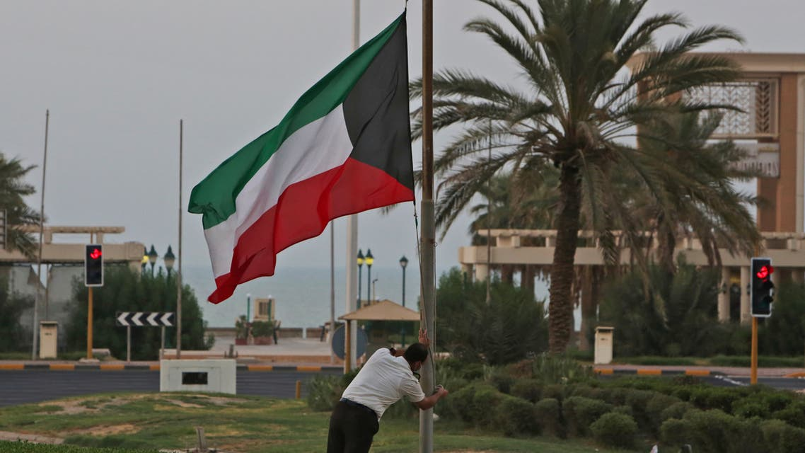 The Kuwaiti flag is lowered to half-mast outside the Dasman Diabetes Institute in Kuwait City on September 29, 2020, as the country mourns the death of emir Sheikh Sabah al-Ahmad Al-Sabah. (AFP)