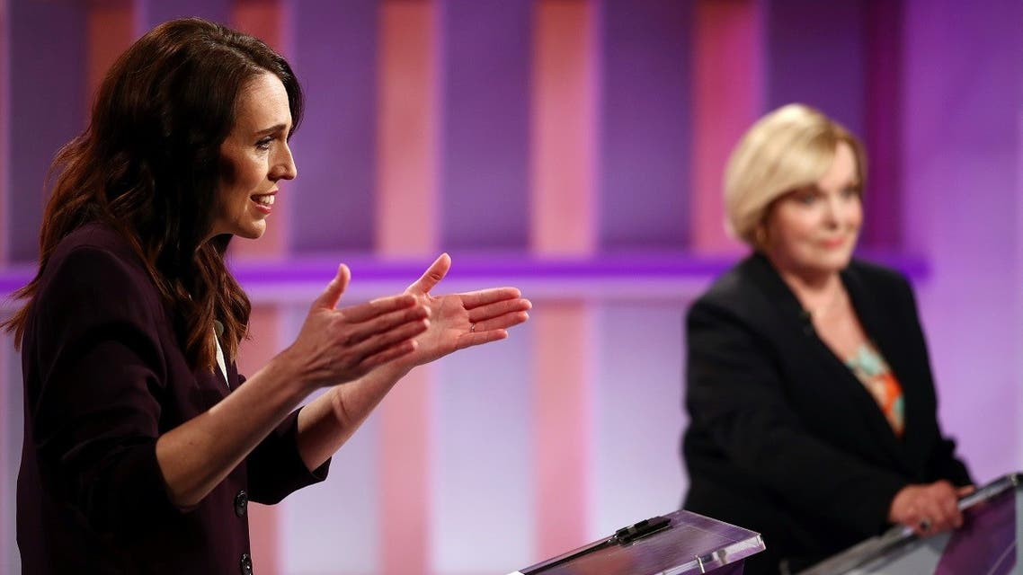 New Zealand Prime Minister Jacinda Ardern (L) and National leader Judith Collins participate in a televised debate at TVNZ in Auckland, New Zealand, September 22, 2020. (Fiona Goodall/Pool via Reuters)
