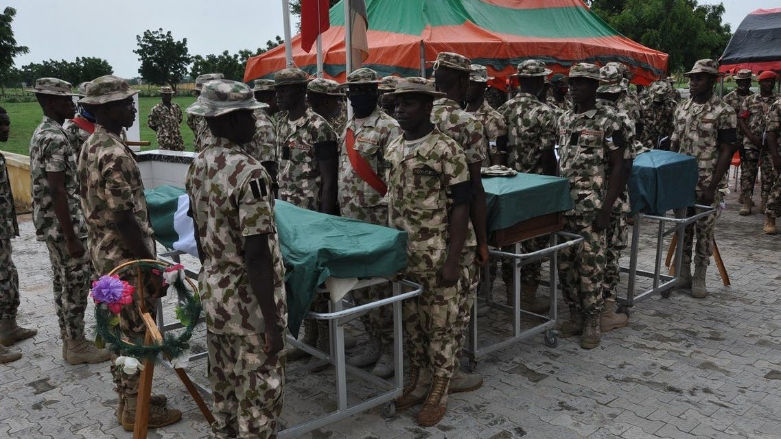 Nigerian soldiers stand on attention during the funeral on September 26, 2020 of the Nigerian soldiers killed in the attack near the shores of Lake Chad. (AFP)
