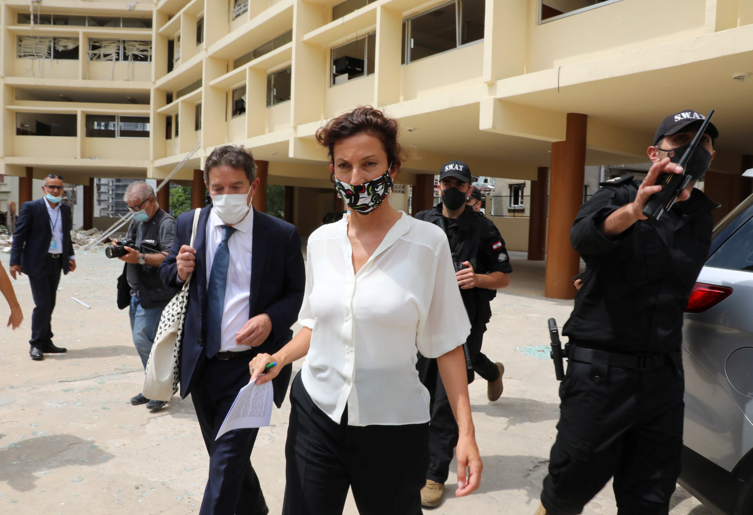 UNESCO Director-General Audrey Azoulay walks at a public school damaged in the massive explosion at Beirut's port area, in Beirut, Lebanon August 27, 2020. (Reuters)