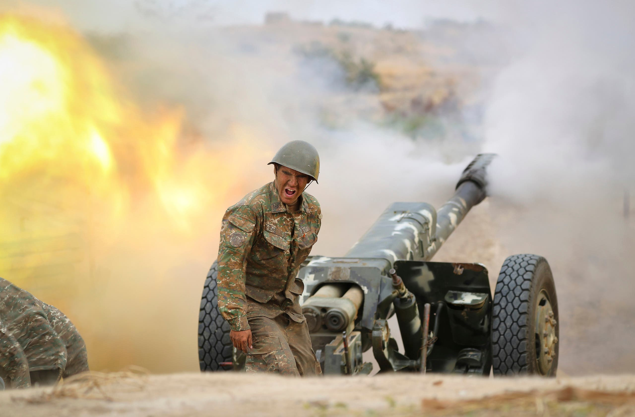 An Armenian serviceman fires a cannon towards Azerbaijan positions in the self-proclaimed Republic of Nagorno-Karabakh, Azerbaijan, Sept. 29, 2020. (AP)