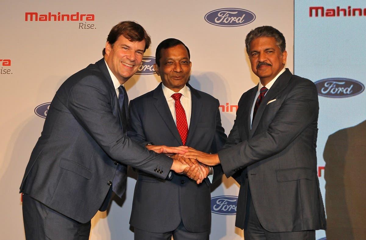 Jim Farley, President of Ford New Businesses, Technology & Strategy, Pawan Goenka, Managing Director of Mahindra & Mahindra Limited, and Anand Mahindra, Chairman of Mahindra Group, in Mumbai, India, on October 1, 2019. (Reuters)