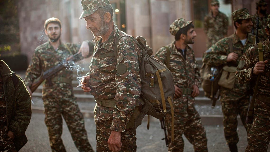Ethnic Armenians volunteer recruits gather at a center where they receive their uniforms and weapons. (AP)
