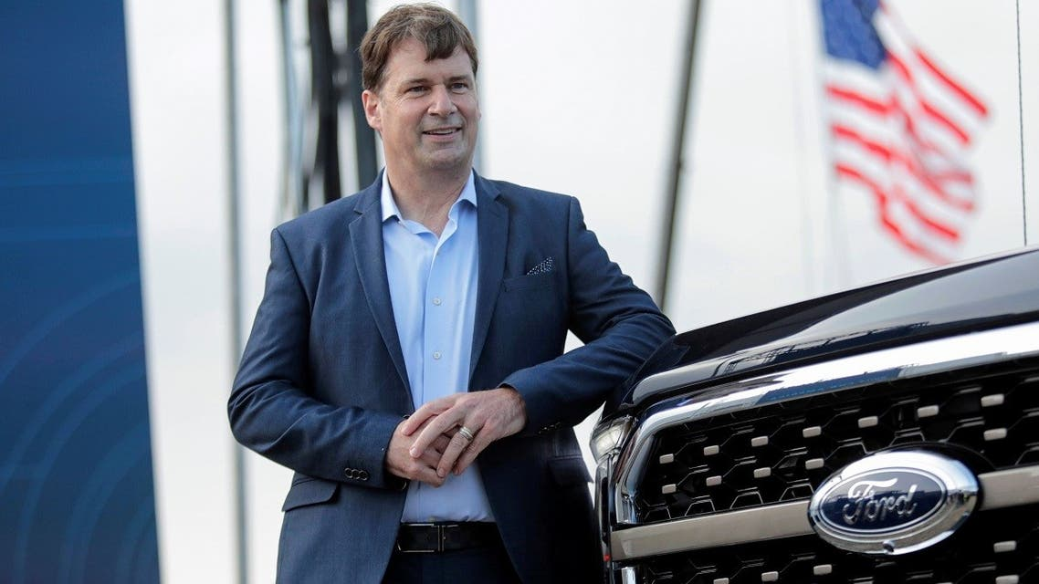 Ford Motor Co. CEO Jim Farley poses next to a new 2021 Ford F-150 pickup truck at the Rouge Complex in Dearborn, Michigan, US. (Reuters)
