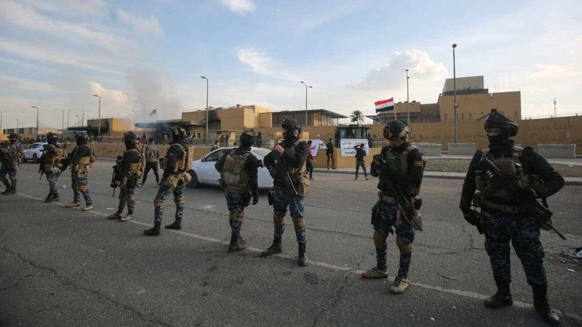 Iraqi security forces are deployed in front of the US embassy in the capital Baghdad on January 1, 2020. (AFP)