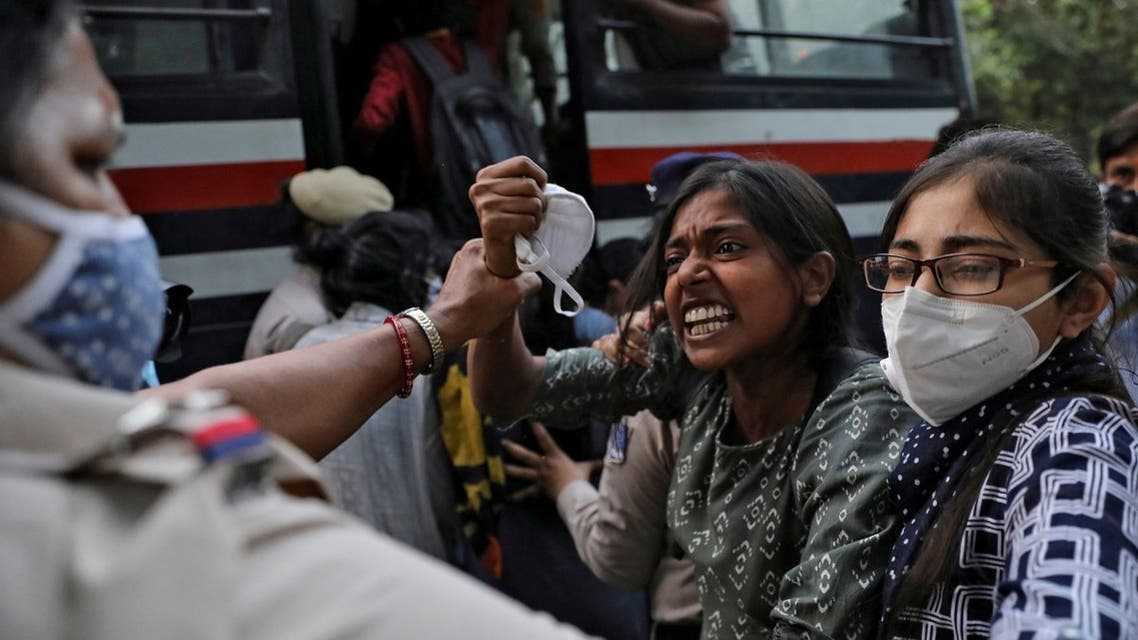 Demonstrators are detained by police during a protest after the death of a rape victim, at Delhi University, in New Delhi, India, October 1, 2020. (Reuters)