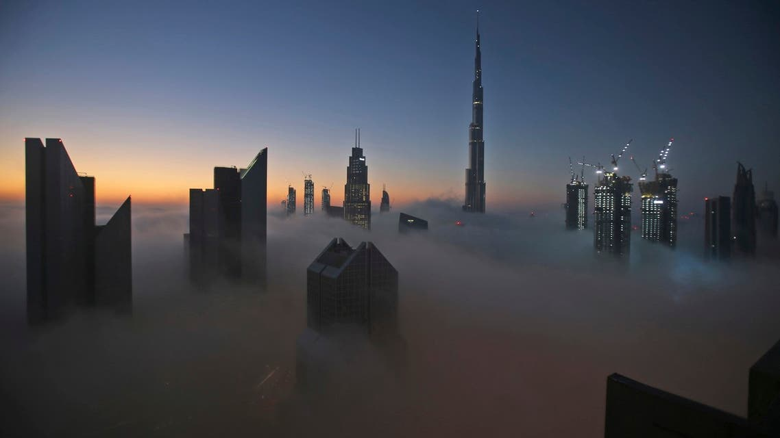 FILE - In this Dec. 31, 2016 file photo, the sun rises over the city skyline with the Burj Khalifa, the world's tallest building, on a foggy day in Dubai, United Arab Emirates. (AP)