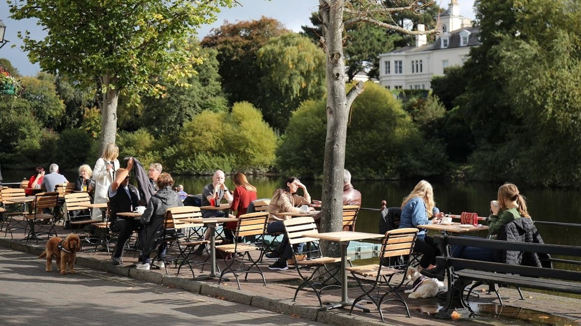 People sit in an outdoor cafe amid the outbreak of the coronavirus in Chester, Britain, on October 1, 2020. (Reuters)