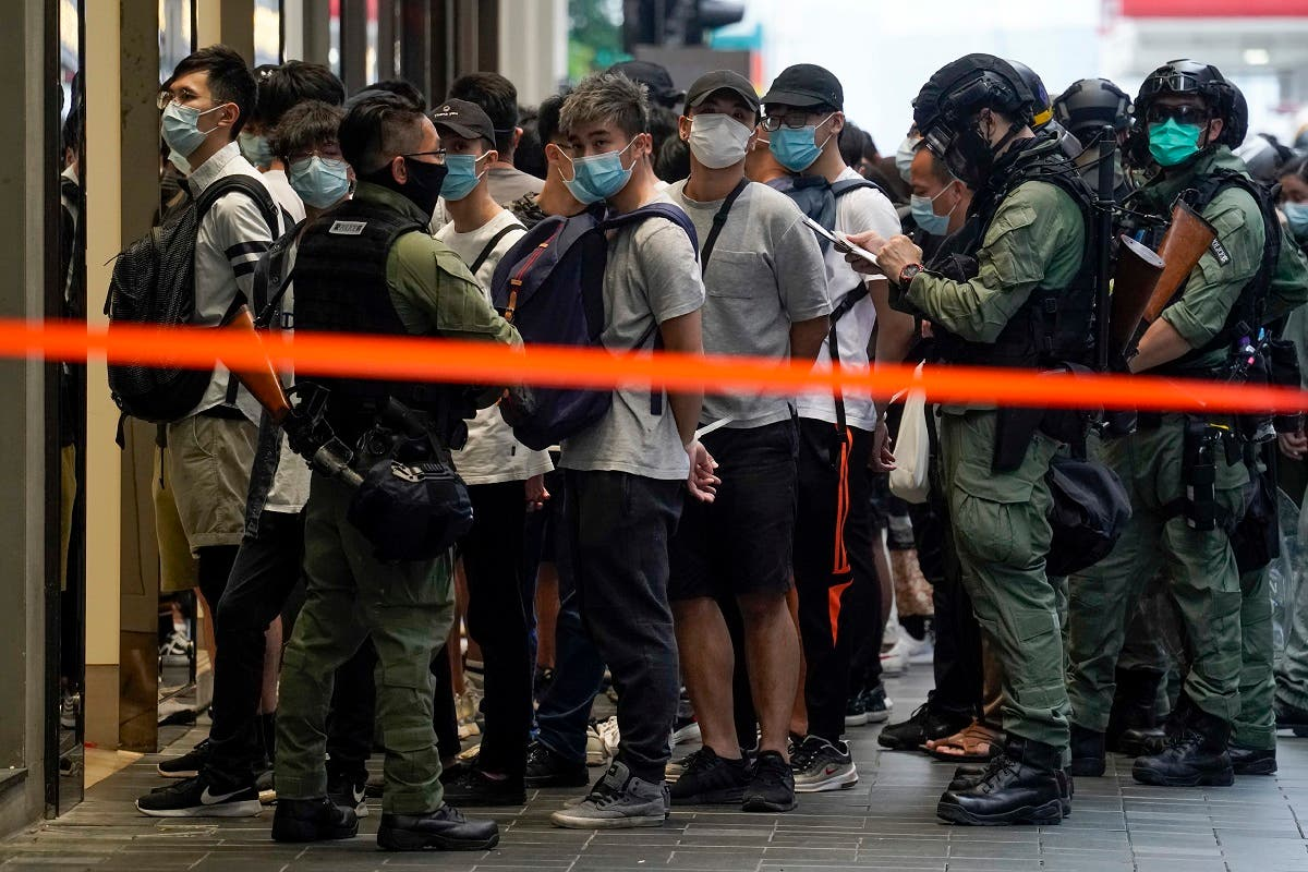 Police detain people inside a cordoned area during China's National Day in Causeway Bay, Hong Kong, on October 1, 2020. (AP)