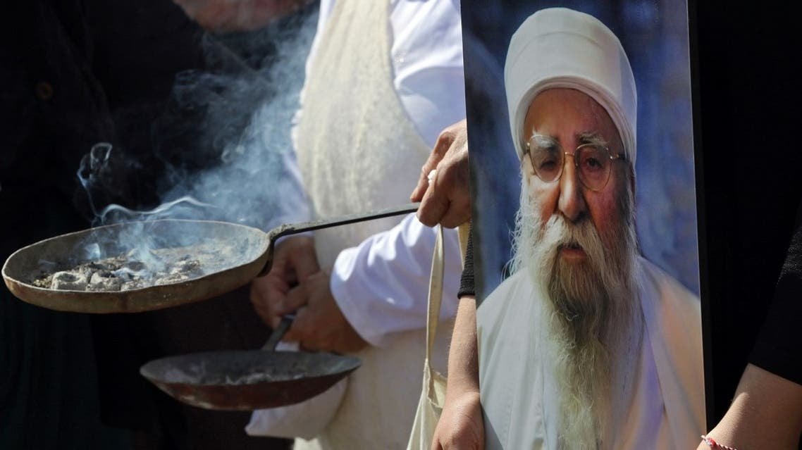 Iraqi Yazidis burn incense during the funeral of Baba Sheikh Khurto Hajji Ismail (image), supreme spiritual leader of the Yazidi religious minority, in the Iraqi town of Sheikhan, 50km northeast of Mosul, on October 2, 2020. (AFP)