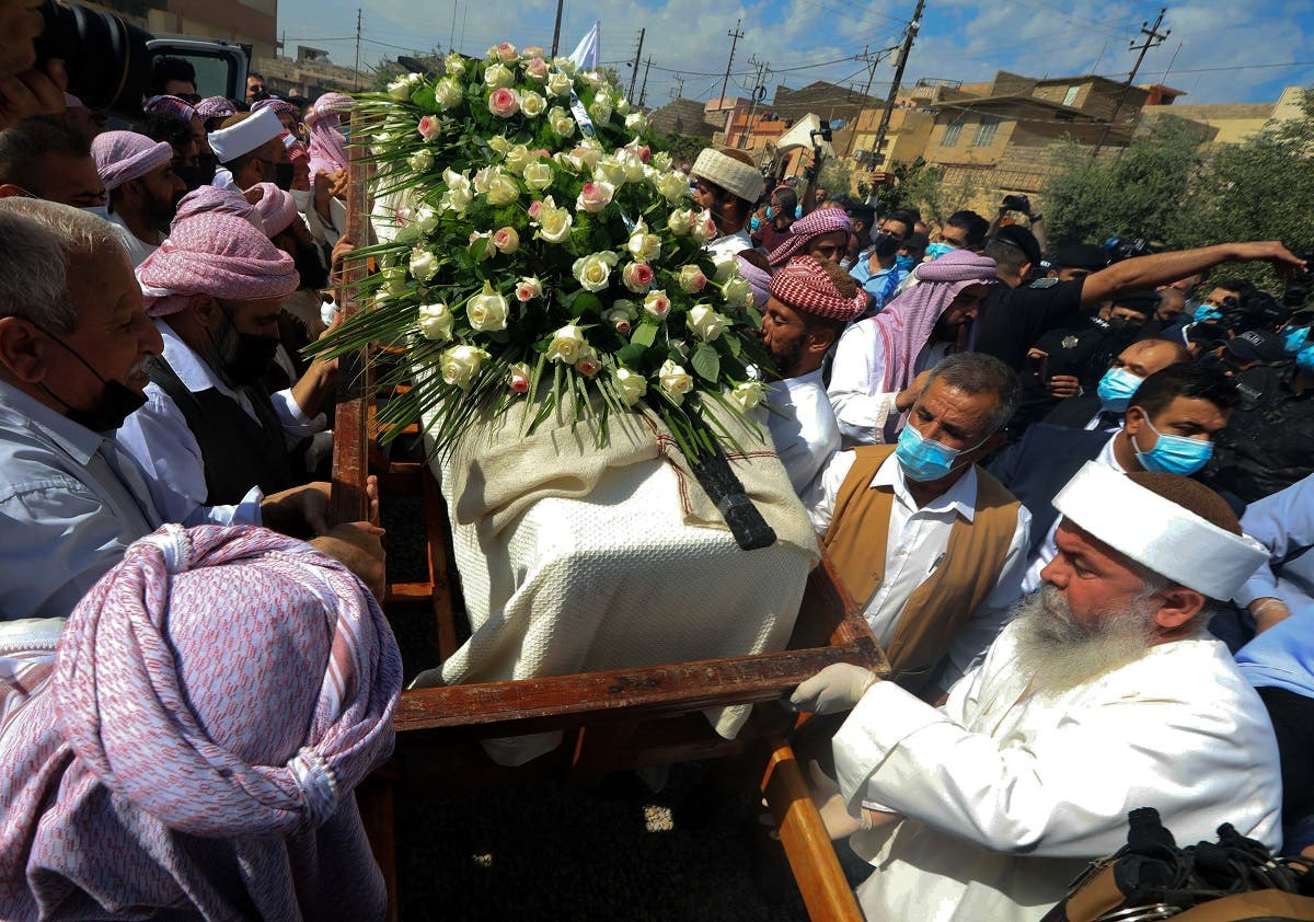 Iraqi Yazidi men surround the casket of Baba Sheikh Khurto Hajji Ismail, supreme spiritual leader of the Yazidi religious minority, during his funeral procession. (AFP)