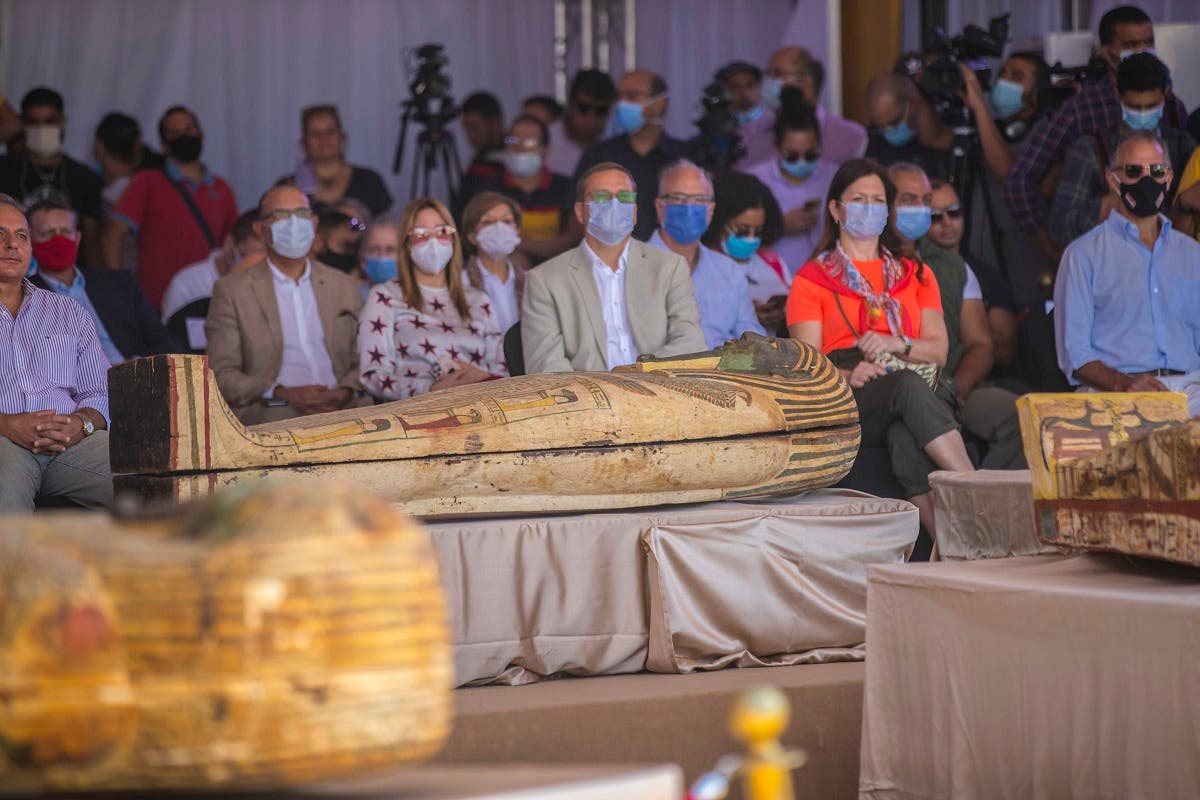 A picture taken on October 3, 2020 shows members of diplomatic missions in Egypt attending a press conference to reveal the new discovery at the Saqqara necropolis, 30 km south of the Egyptian capital Cairo. (AFP)