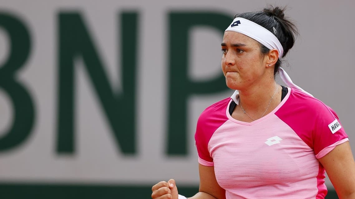 Tunisia's Ons Jabour reacts after winning a point against Belarus' Aryna Sabalenka during their women's singles third round tennis match on Day 7 of The Roland Garros 2020 French Open tennis tournament in Paris on October 3, 2020. (AFP)