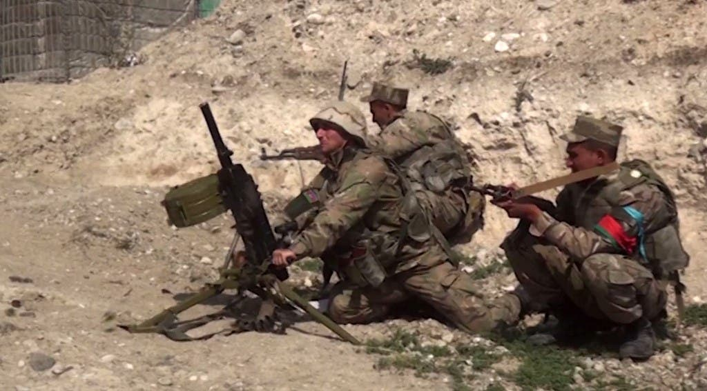 An image grab taken from a video made available by the Azeri Defense Ministry on September 28, 2020, allegedly shows Azeri troops during clashes between Armenian separatists and Azerbaijan in the region of Nagorno-Karabakh. (AFP)