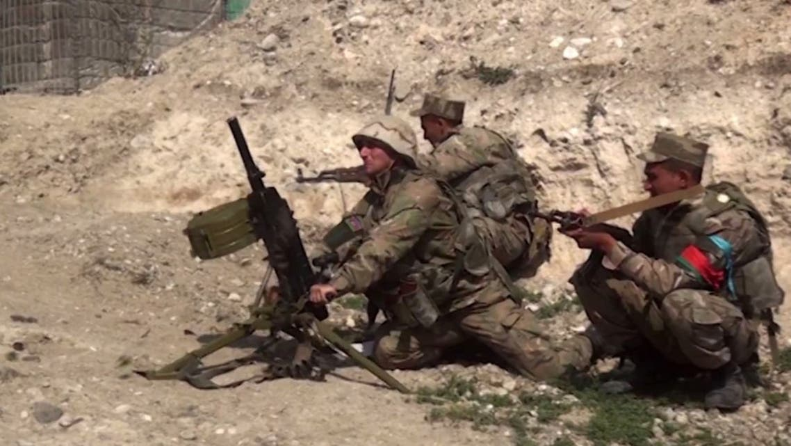 An image grab taken from a video made available on the official web site of the Azerbaijani Defence Ministry on September 28, 2020, allegedly shows Azeri troops conducting a combat operation during clashes between Armenian separatists and Azerbaijan in the breakaway region of Nagorno-Karabakh. (AFP)