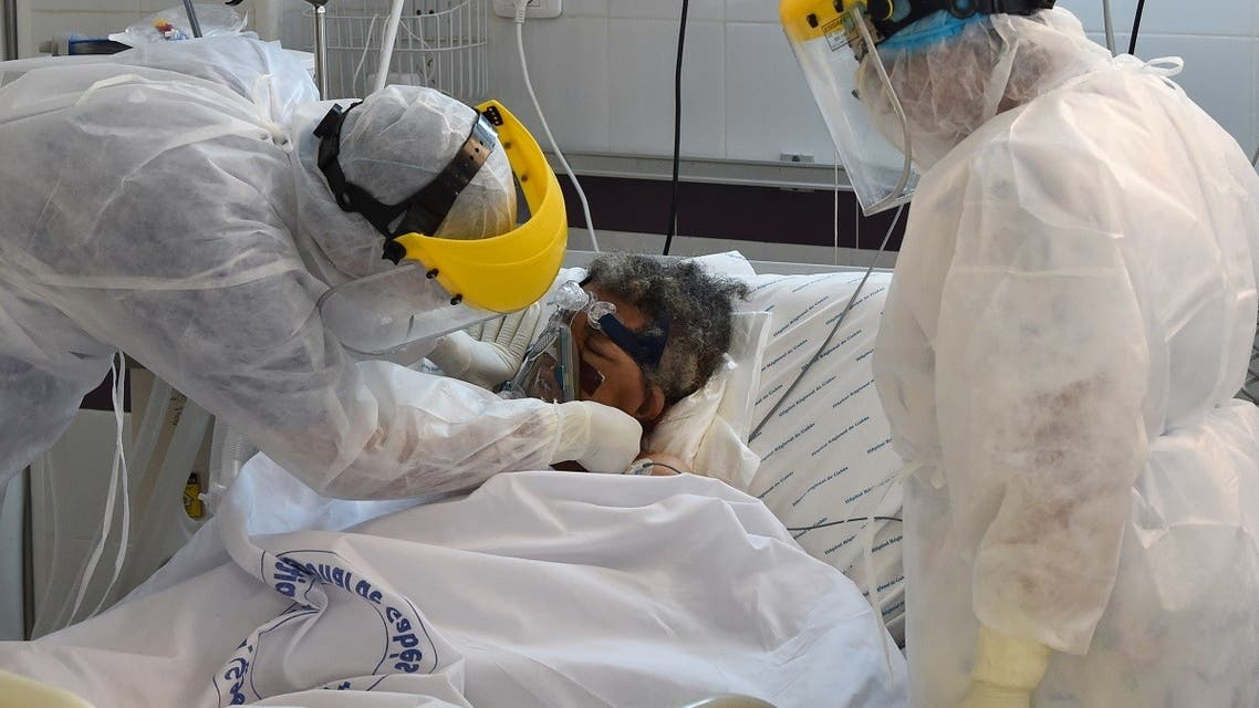 A patient infected by coronavirus receives treatment at the intensive care unit of a hospital in the southwestern Tunisian town of Gabes, August 26, 2020. (AFP)