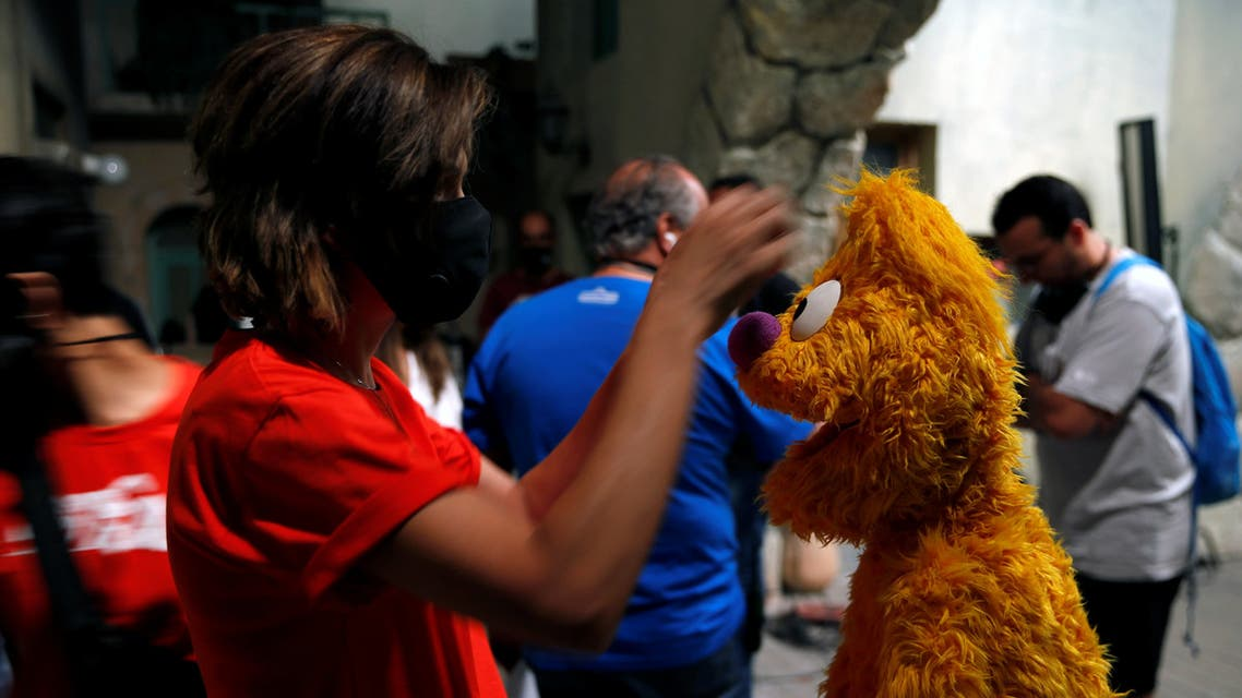 Staff of the children program Ahlan Simsim prepare puppets for filming a scene on the set of the show in a studio in Amman, Jordan. (Reuters)