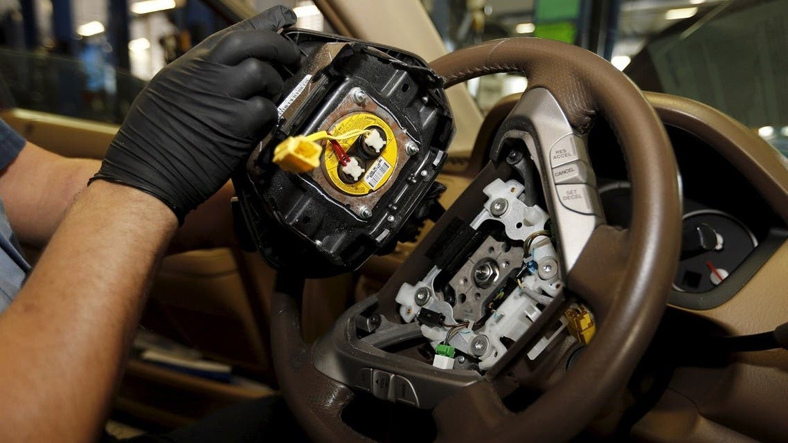A file photo shows a technician holds a recalled Takata airbag inflator after he removed it from a Honda Pilot at the AutoNation Honda dealership service department in Miami, Florida June 25, 2015. (Reuters)