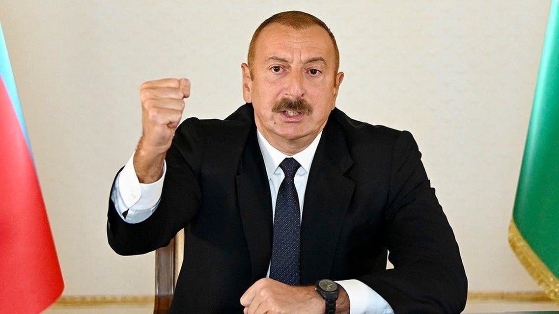 In this photo provided by the Azerbaijan's Presidential Press on Sept. 27, 2020, Azerbaijani President Aliyev addresses the nation in Baku, Azerbaijan. (Azerbaijani Presidential Press Office via AP)