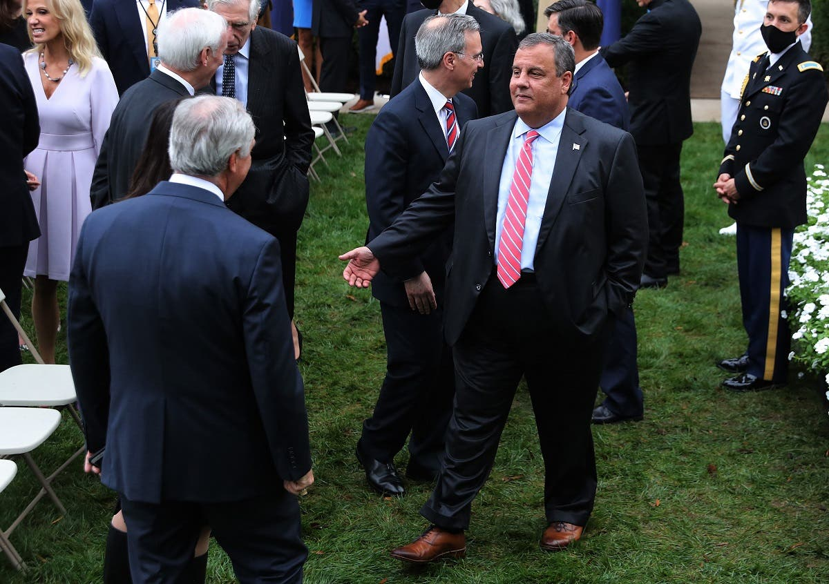In this file photo taken on September 26, 2020, former New Jersey Governor Chris Christie (C) talks with guests in the Rose Garden after President Donald Trump nominated Judge Amy Coney Barrett to the Supreme Court at the White House in Washington, DC. (AFP)