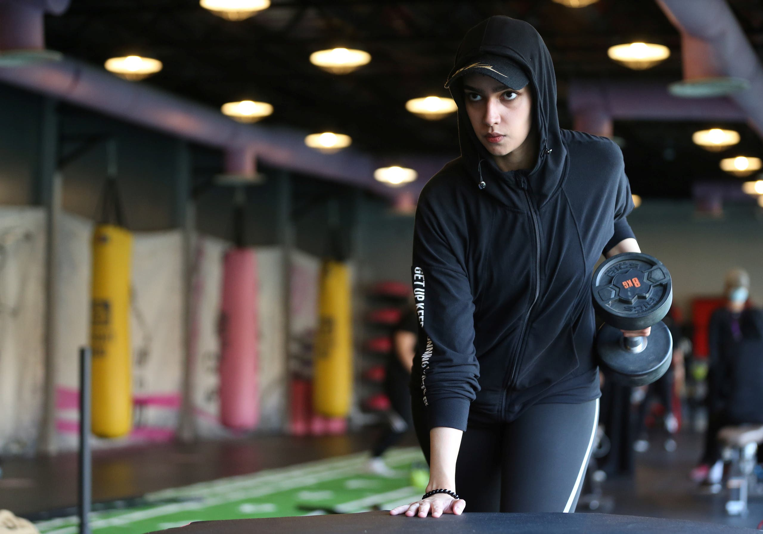 A Saudi woman, Fayrouz Al-Omari, works out at a gym, amid the spread of the coronavirus disease (COVID-19), in Riyadh, Saudi Arabia September 24, 2020. (Reuters)