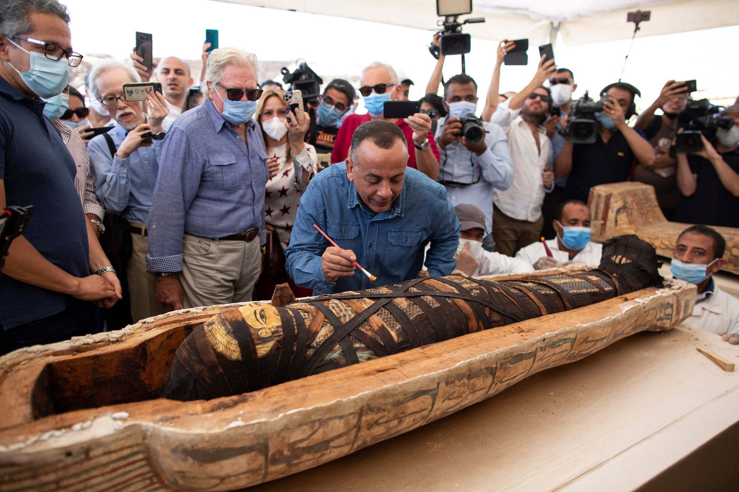 Mostafa Waziri, the secretary-general of the Supreme Council of Antiquities, center, reacts after opening the sarcophagus that is around 2500 years old at the Saqqara archaeological site, 30 kilometers (19 miles) south of Cairo, Egypt, Saturday, Oct. 3, 2020. (AP)