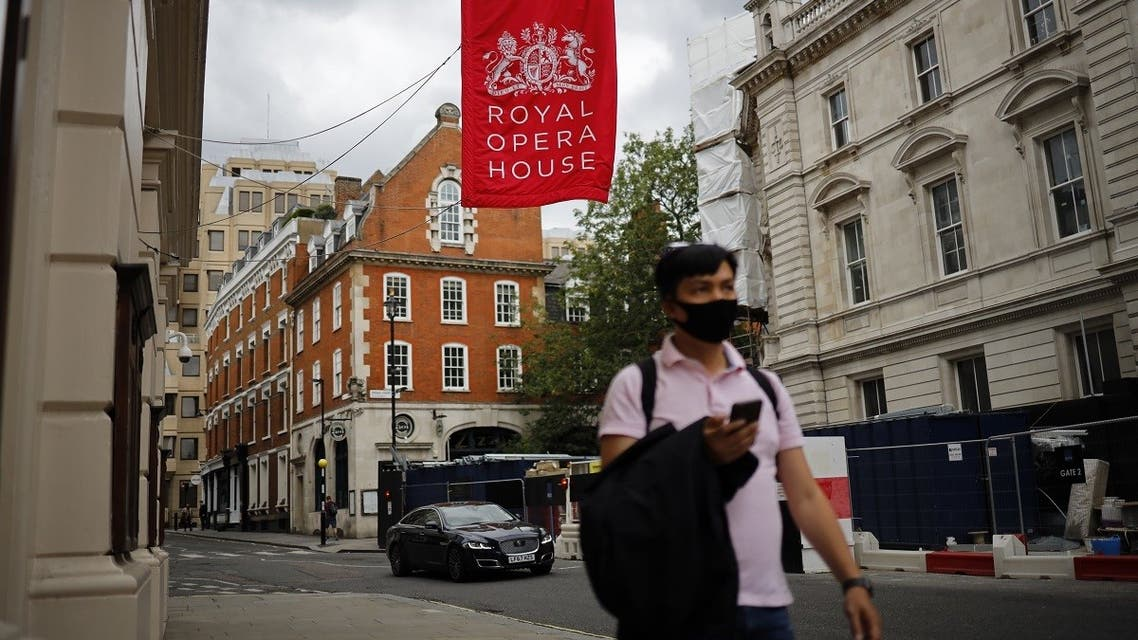 A pedestrian passes the Royal Opera House, which remains closed due to restrictions to slow the spread of the novel coronavirus, in London's West End on July 6, 2020. (AFP)