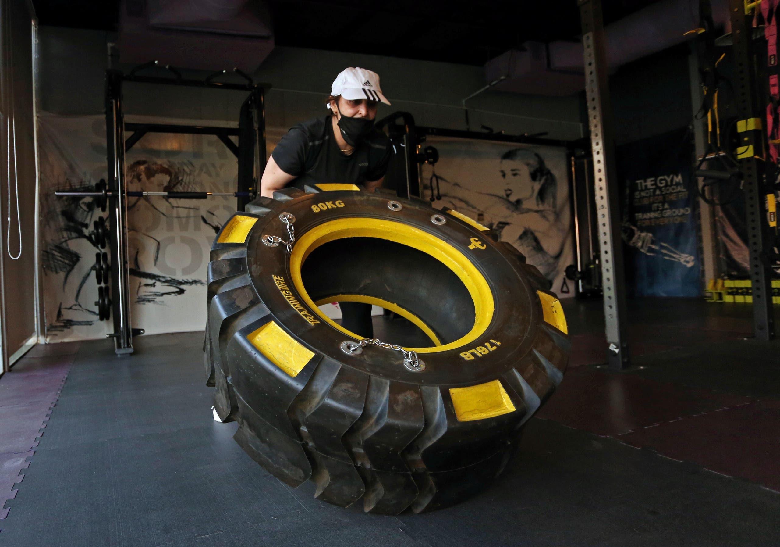 A woman works out at a gym, amid the spread of the coronavirus disease (COVID-19), in Riyadh, Saudi Arabia. (Reuters)