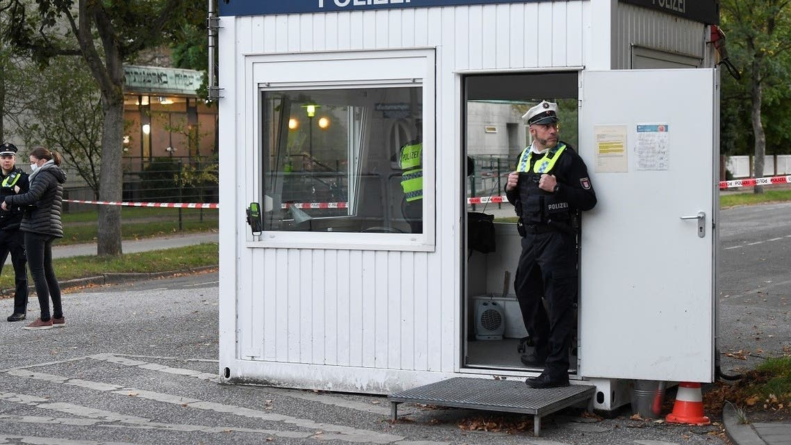 Police members secure the area where a Jewish man was attacked, in front of the Hamburg synagogue, Hamburg, Germany October 4, 2020. (Reuters)