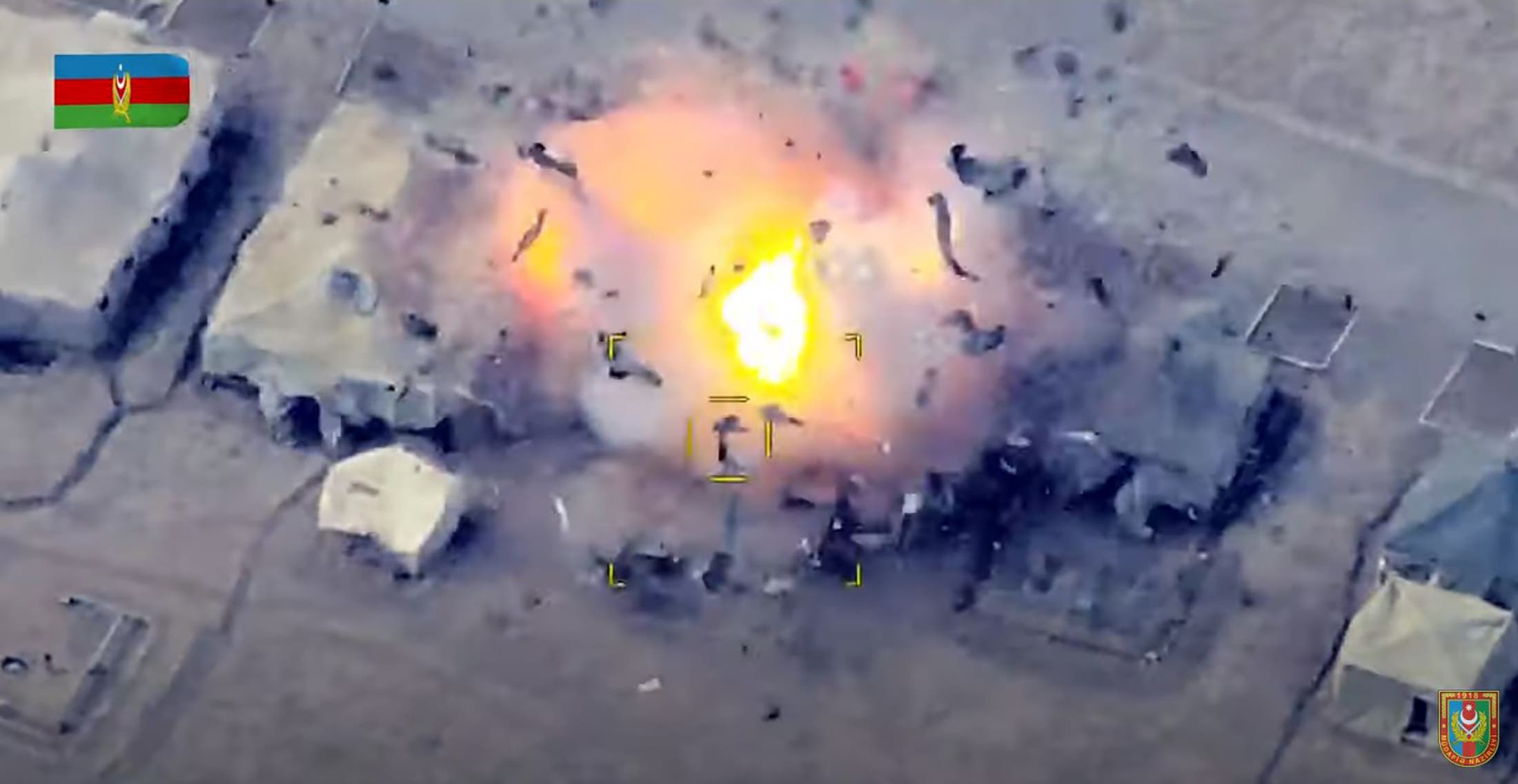 An image grab taken from a video made available on the official web site of the Azerbaijani Defence Ministry on October 2, 2020, allegedly shows Azeri units destroying an Armenian field control post. (AFP)
