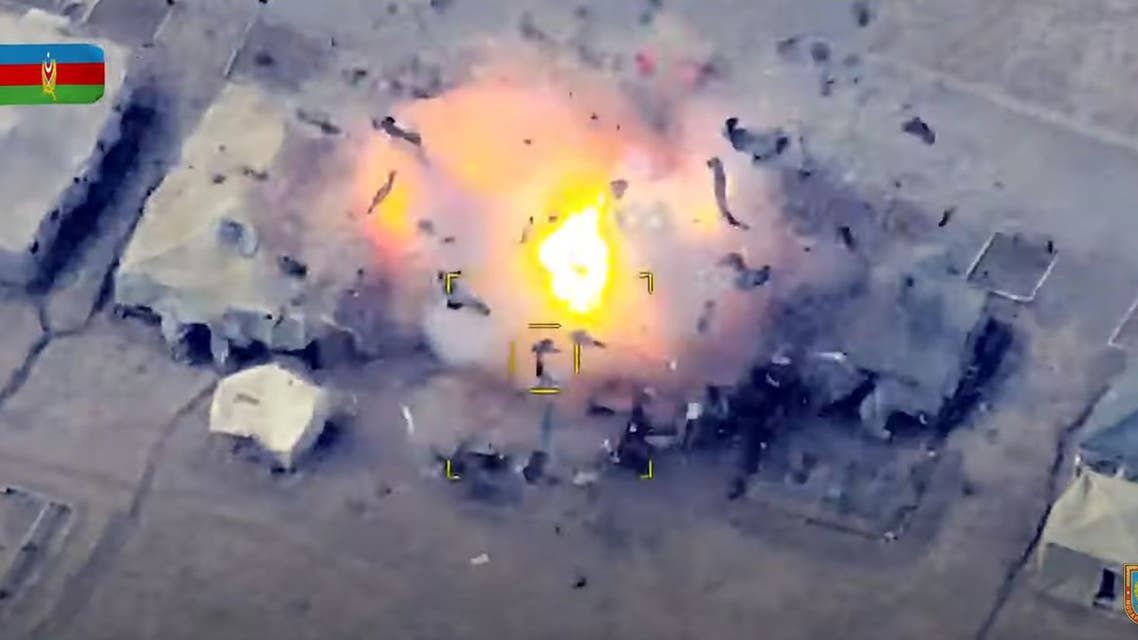 An image grab taken from a video made available on the official web site of the Azerbaijani Defence Ministry on October 2, 2020, allegedly shows Azeri units destroying an Armenian field control post during fighting over the breakaway Nagorno-Karabakh region. (AFP)
