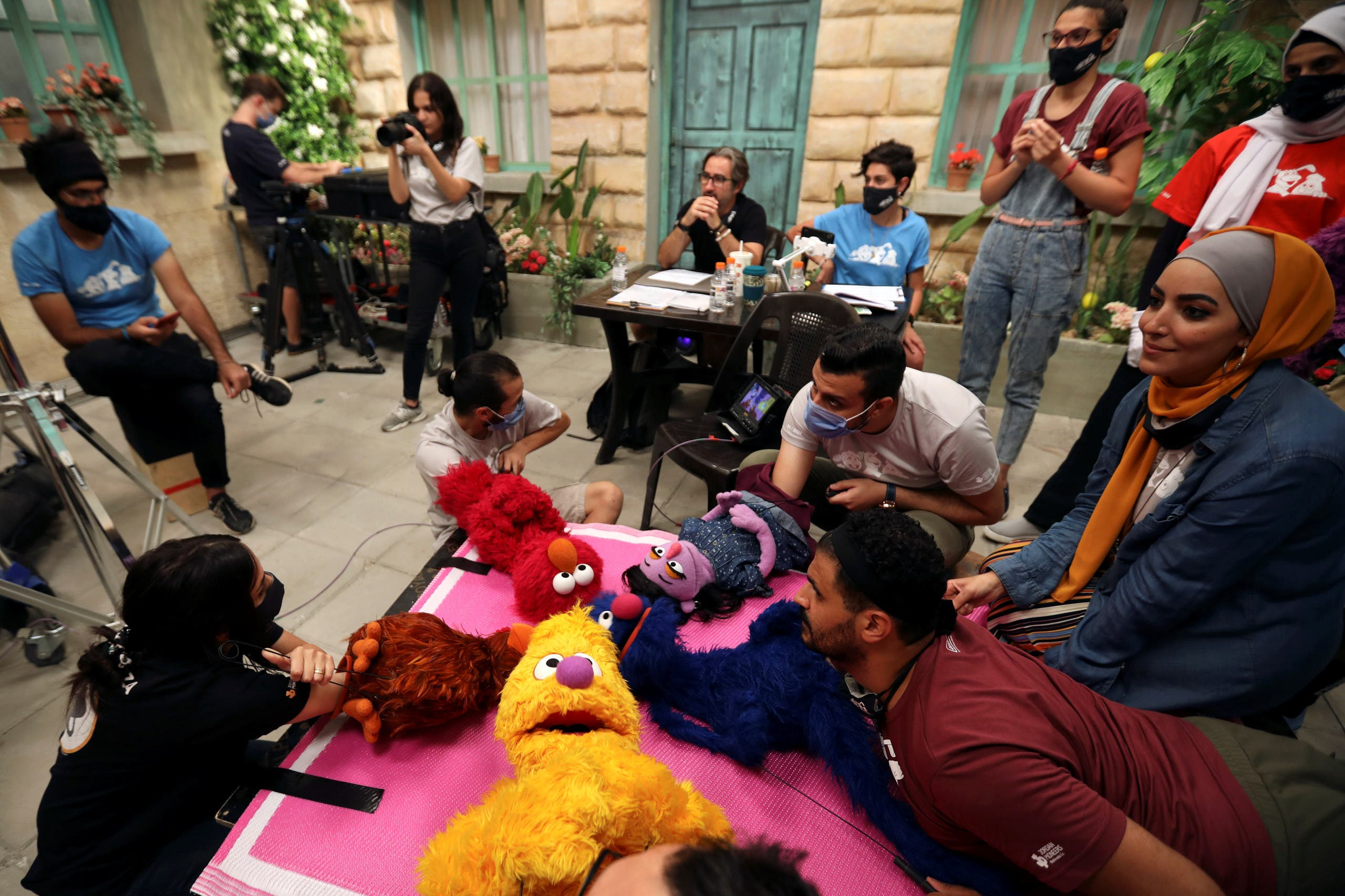 The staff of the children program Ahlan Simsim are seen as they film a scene on the set of the show in a studio in Amman, Jordan. (Reuters