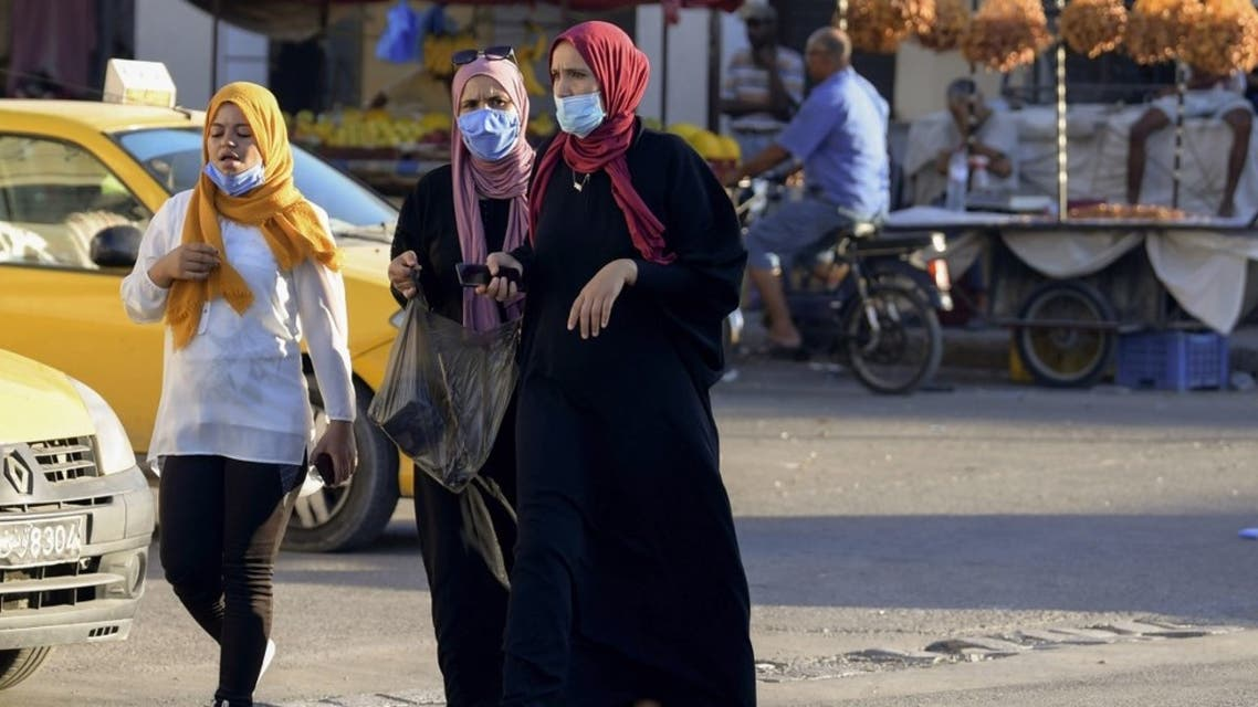 Tunisian women wear face masks for protection against the novel coronavirus at a market in the southwestern Tunisian town of Gabes on August 26, 2020, as cases of infection surge there. (AFP)