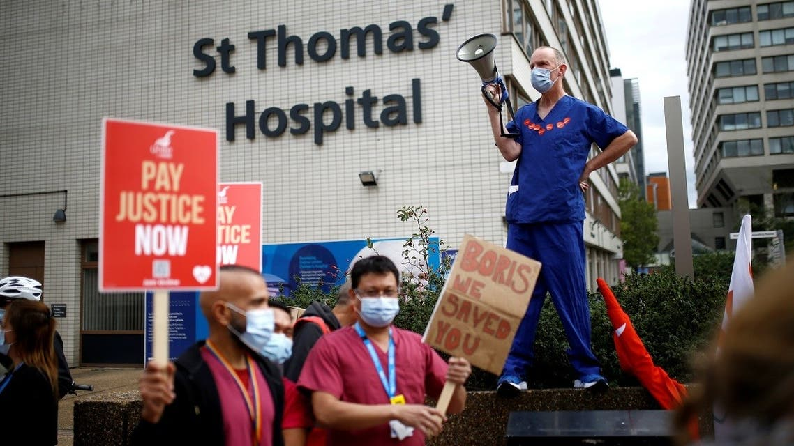 An NHS staff member holds a megaphone during a protest asking for a pay rise, amid the spread of the coronavirus disease (COVID-19), in London. (Reuters)