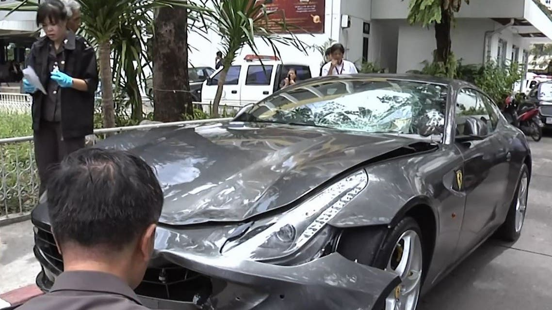 This frame grab from video footage taken on September 3, 2012 and received from Thai PBS via AFPTV on September 1, 2020 shows police inspecting the Ferrari car belonging to Red Bull heir Vorayuth Boss Yoovidhya in Bangkok, after a hit-and-run case which resulted in the death of a police officer. (AFP)