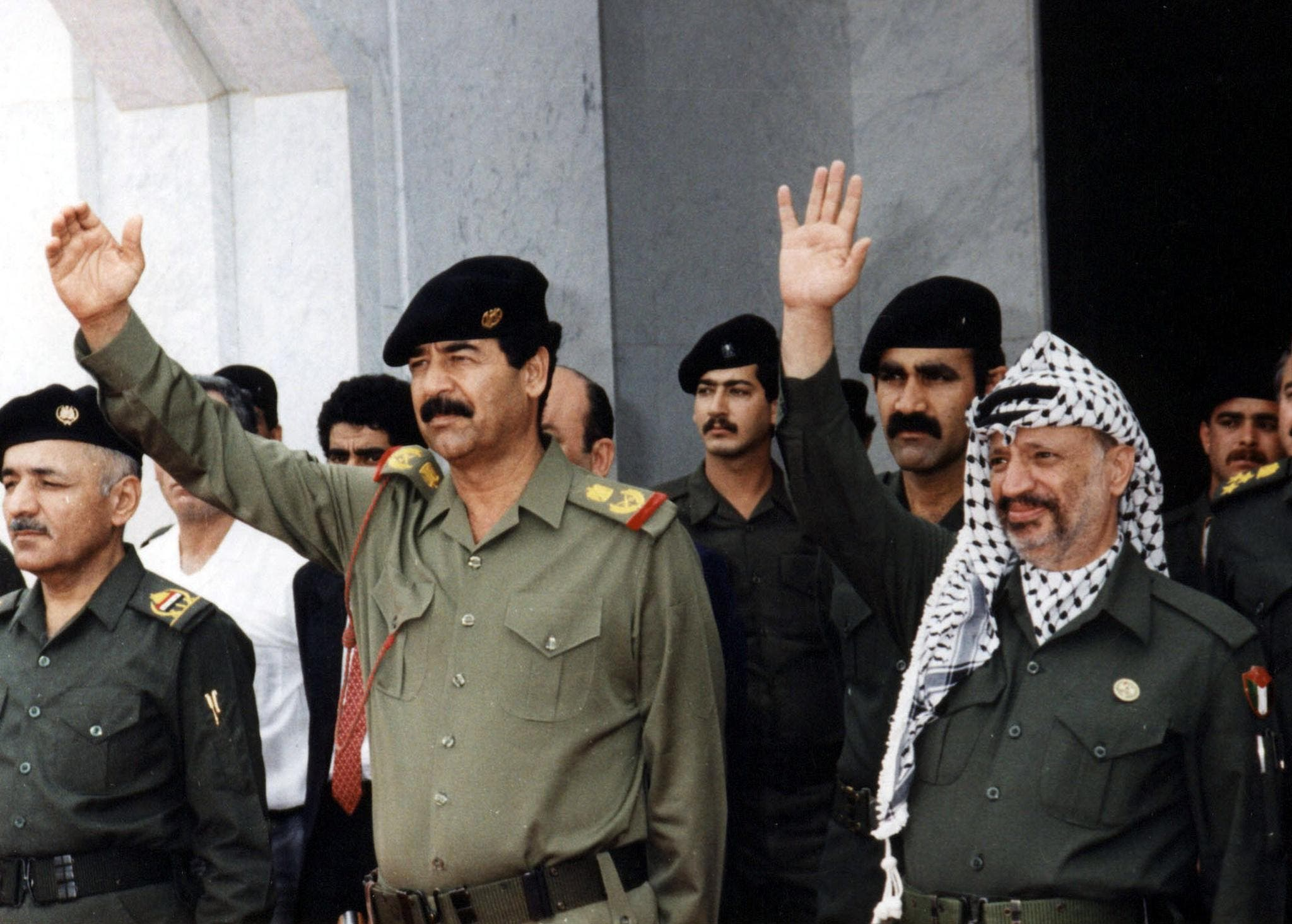 A photo from the files of the Palestinian Authority's press office (PPO) shows Palestinian leader Yasser Arafat (R) with Iraq's deposed president Saddam Hussein in Baghdad,  22 October, 1988. (AFP)
