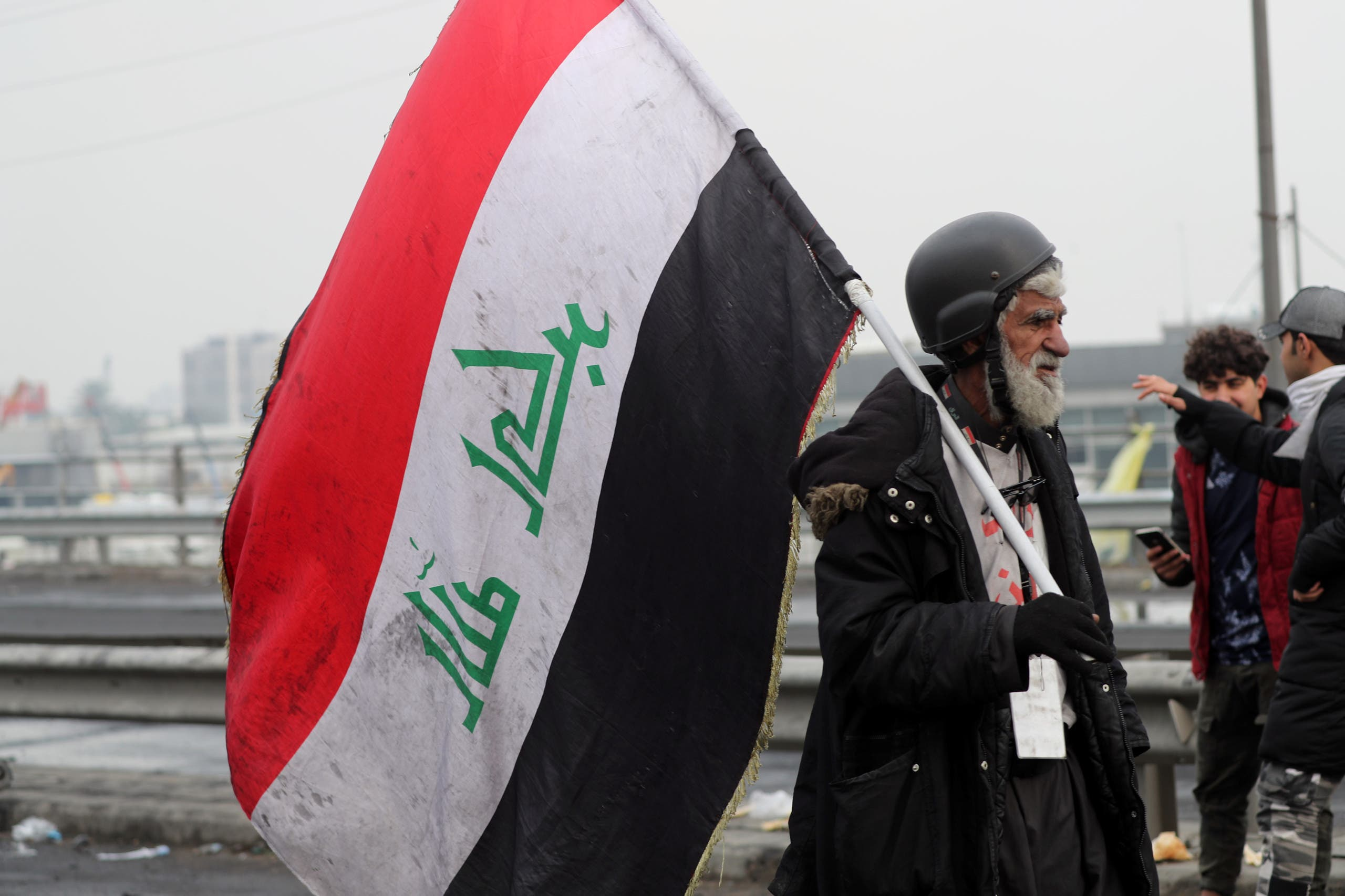 An Iraqi demonstrator holds an Iraqi flag during ongoing anti-government protests in Baghdad, Iraq, January 23, 2020. (Reuters)